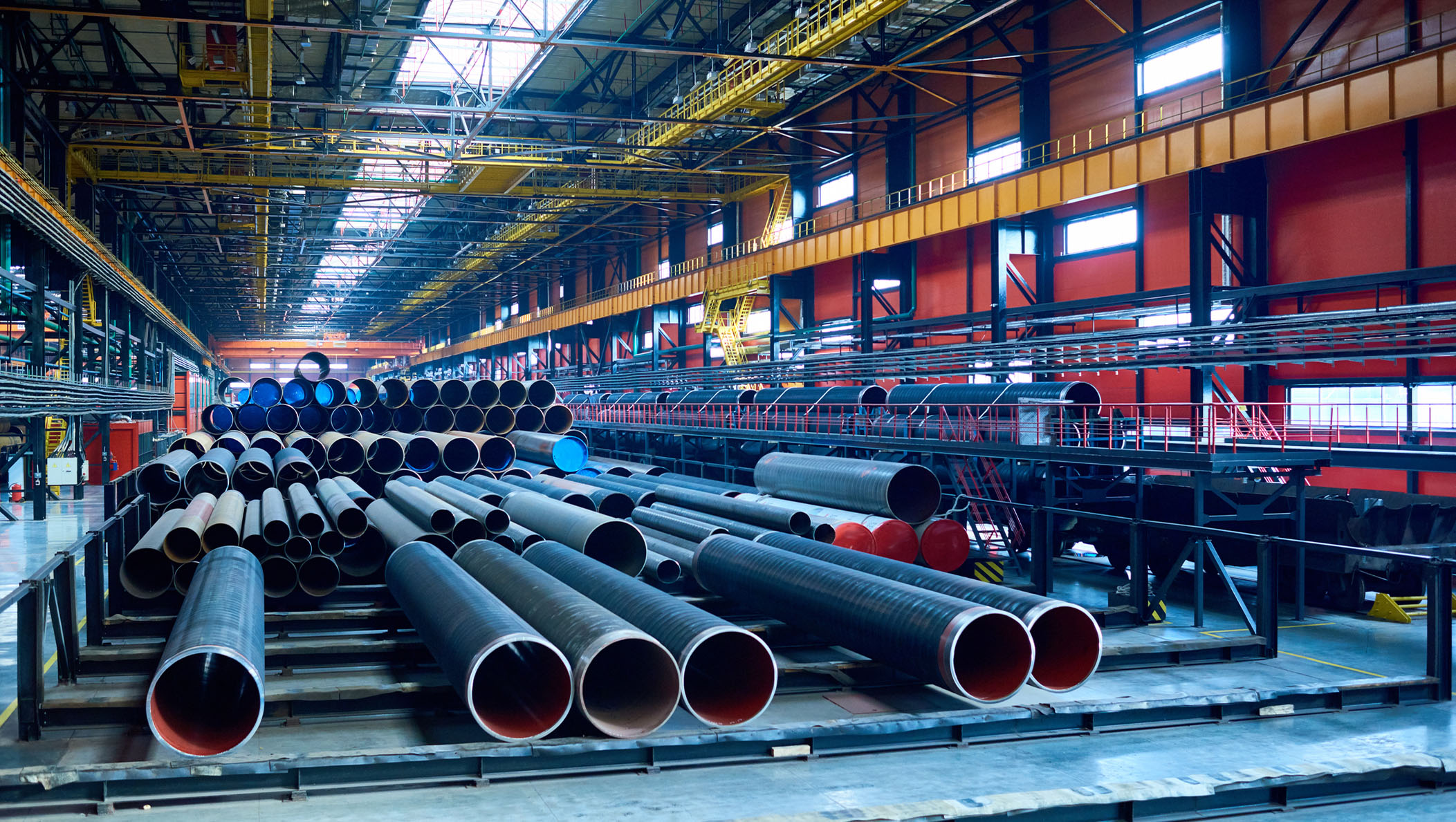 An abundance of tubes used for oil and gas industry placed in factory warehouse